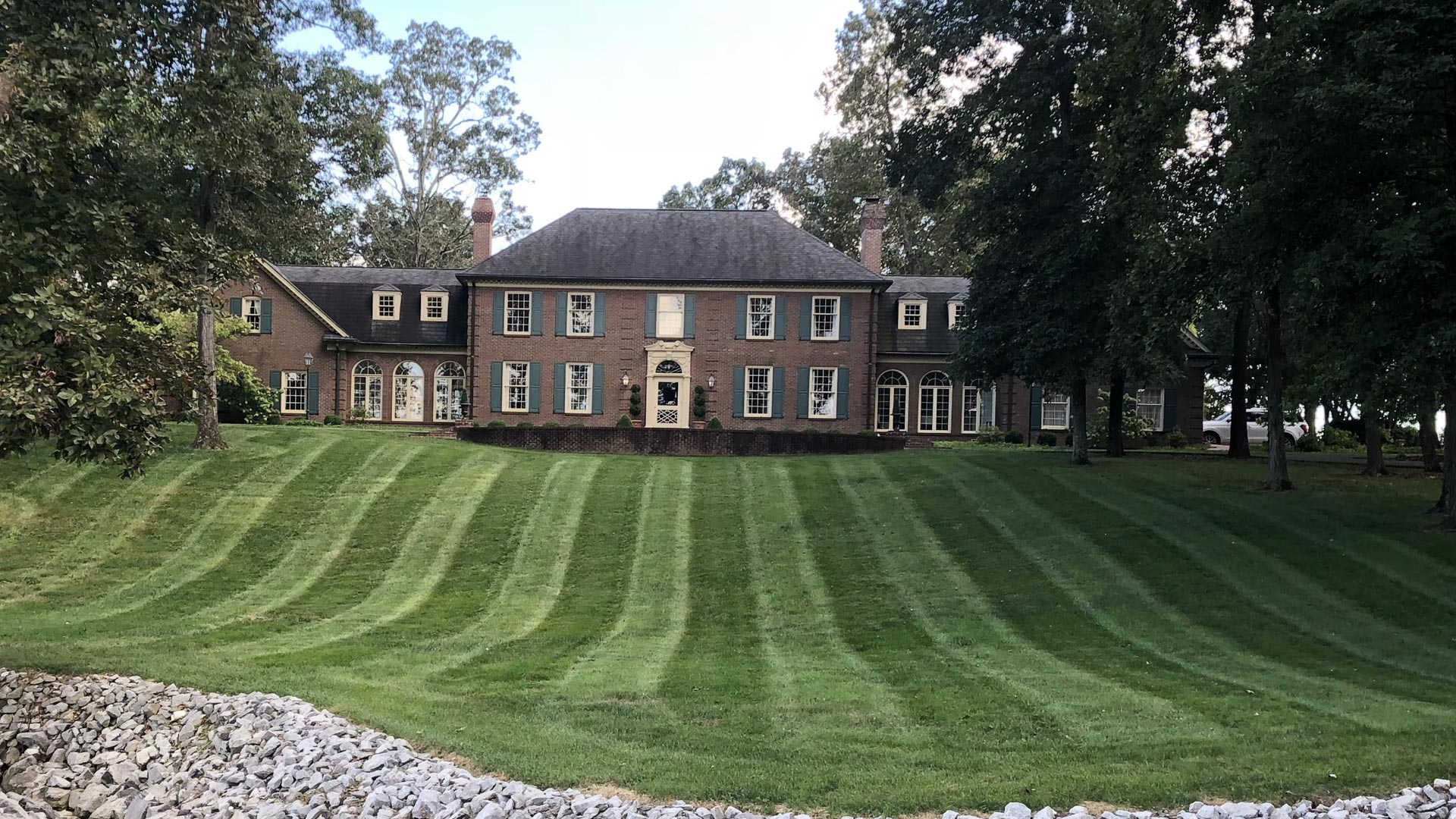 Large front lawn at a private residential property in Murray, KY.