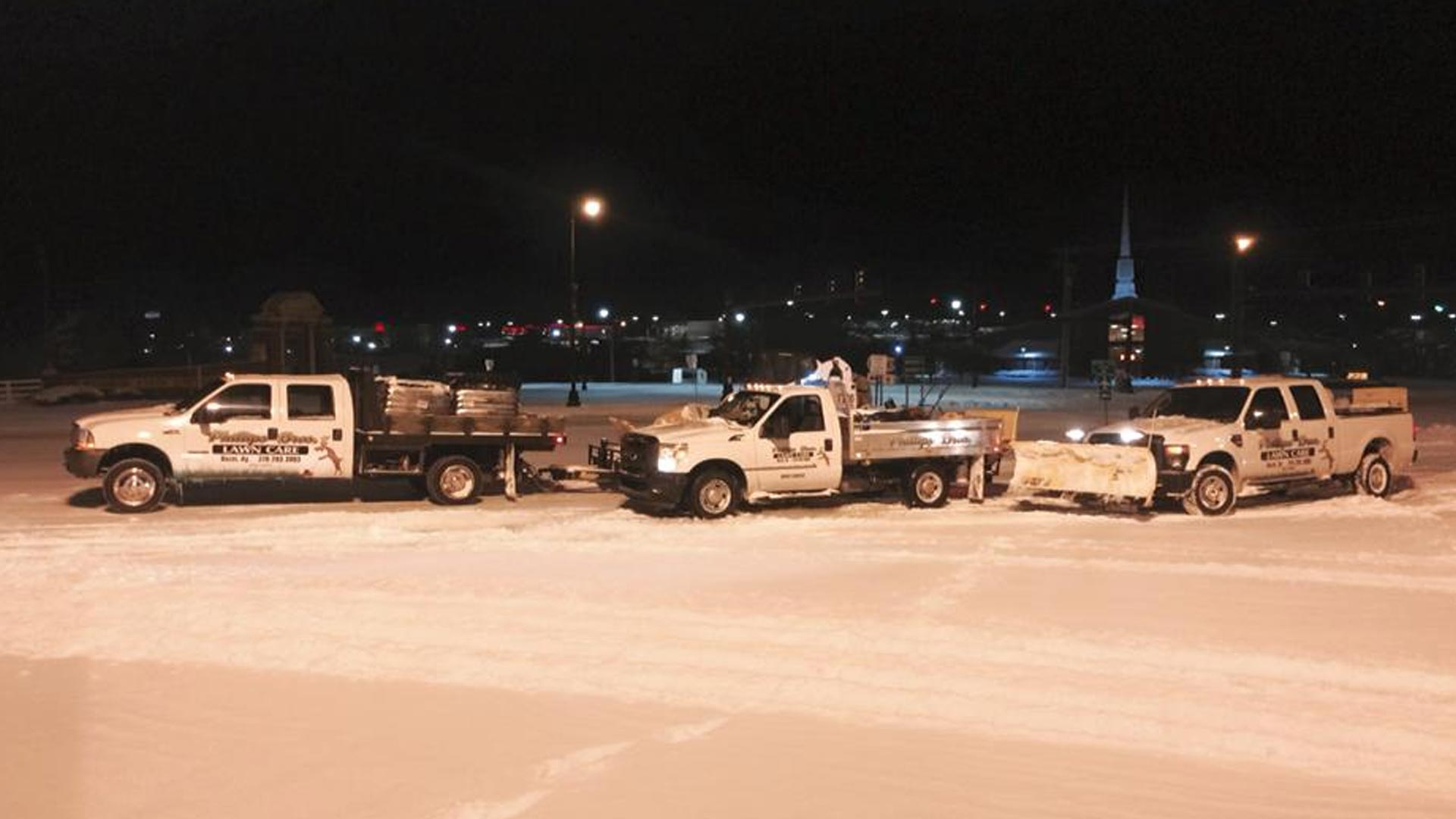 We use our snow plows to clear the parking lots of our clients.