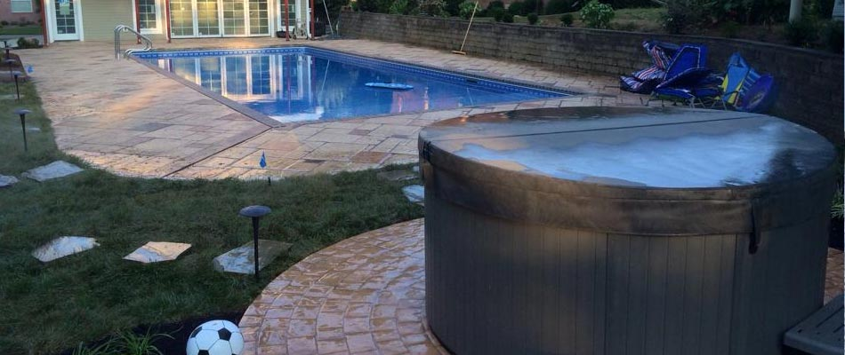 We have designed and built pavers around a pool and a stone paver pad for their hot tub  in Mayfield.