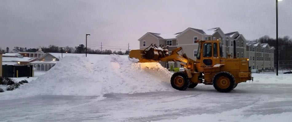 Our large plow moving snow in a parking lot at a apartment complex in Mayfield, KY.