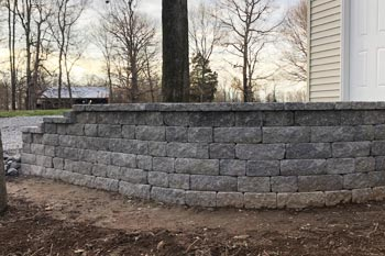 New retaining wall installed to help with erosion for a driveway at a residential property in Benton, KY.